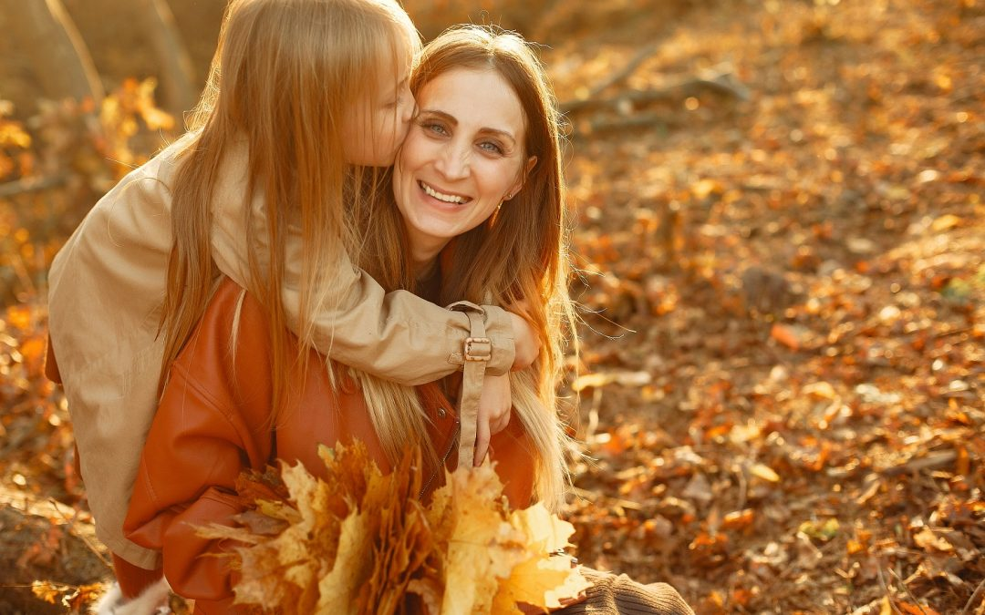 Mother and daughter in park