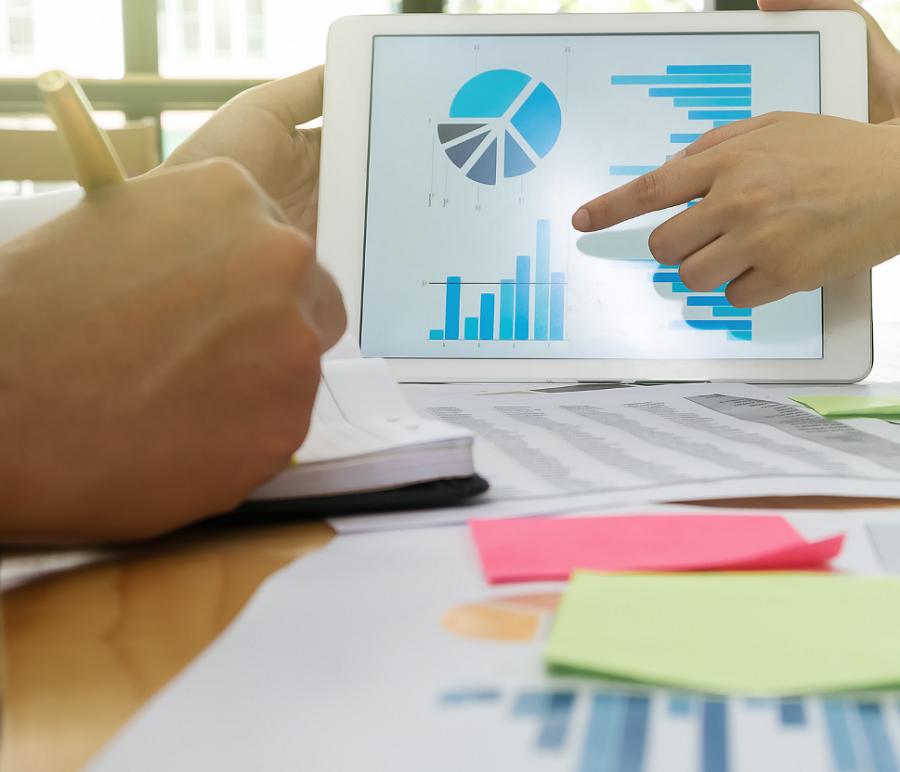 financial advisor showing statistics on tablet